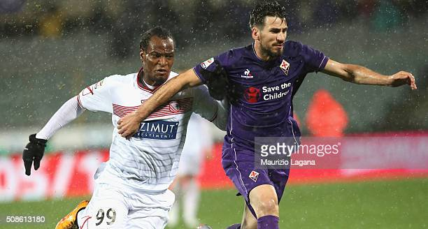 Gonzalo Rodriguez of Fiorentina competes with Jerry Mbakogu of Carpi during the Serie A match between ACF Fiorentina and Carpi FC at Stadio Artemio...