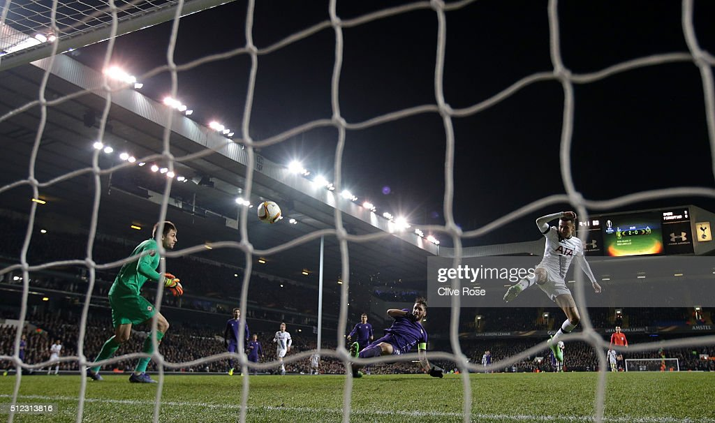 Gonzalo Rodriguez (C) of Fiorentina kicks the ball to score an own goal during the UEFA Europa League round of 32 second leg match between Tottenham Hotspur and Fiorentina at White Hart Lane on February 25, 2016 in London, United Kingdom.