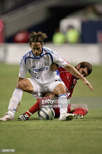 Gonzalo Segares of the Chicago Fire and Josh Wolff of the Kansas City Wizards vie for the ball during their MLS match on August 10 2005 at Soldier...