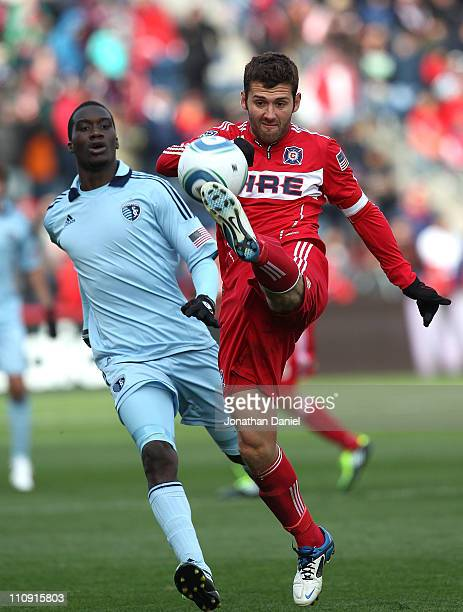 Gonzalo Segares of the Chicago Fire kicks the ball as CJ Sapong of Sporting Kansas City gives chase during an MLS match at Toyota Park on March 26...