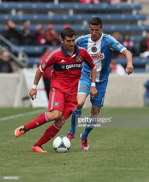 Gonzalo Segares of the Chicago Fire moves under pressure from Sebastien Le Toux of the Philadelphia Union during an MLS match at Toyota Park on May...