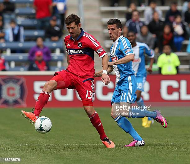 Gonzalo Segares of the Chicago Fire passes the ball in front of Sebastien Le Toux of the Philadelphia Union during an MLS match at Toyota Park on May...