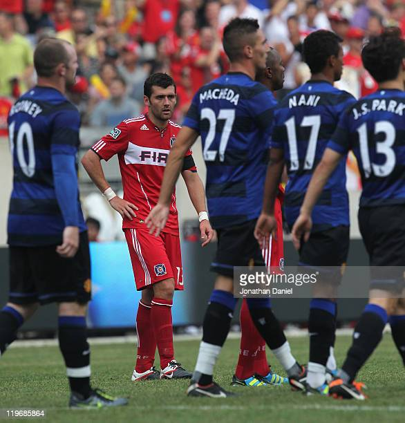 Gonzalo Segares of the Chicago Fire watches as members of Manchester United walk to midfield after scoring a second half goal in a friendly match...