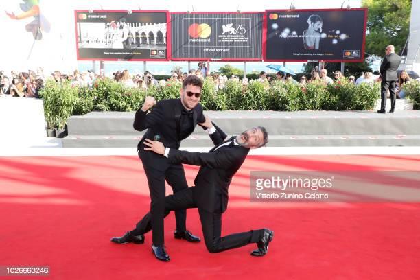 Gonzalo Tobal and Leonardo Sbaraglia walk the red carpet ahead of the 'Acusada ' screening during the 75th Venice Film Festival at Sala Grande on...