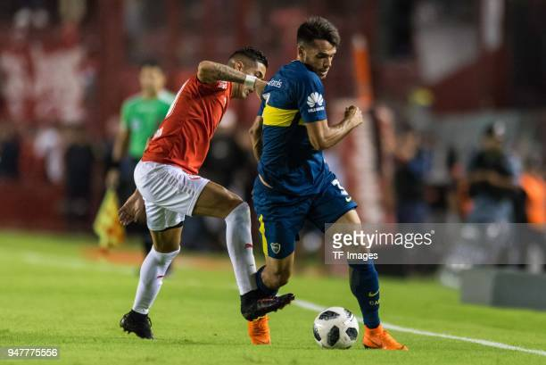 Gonzalo Veron of Independiente and Emanuel Mas of Boca Juniors battle for the ball during a match between Independiente and Boca Juniors as part of...