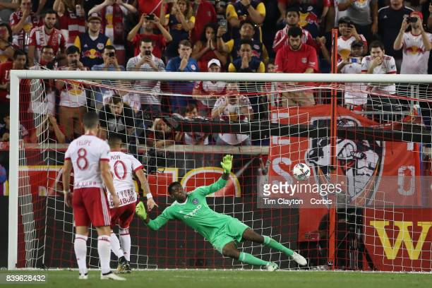 Gonzalo Veron of New York Red Bulls beats Sean Johnson of New York City FC from the penalty sport to equalize during the New York Red Bulls Vs New...