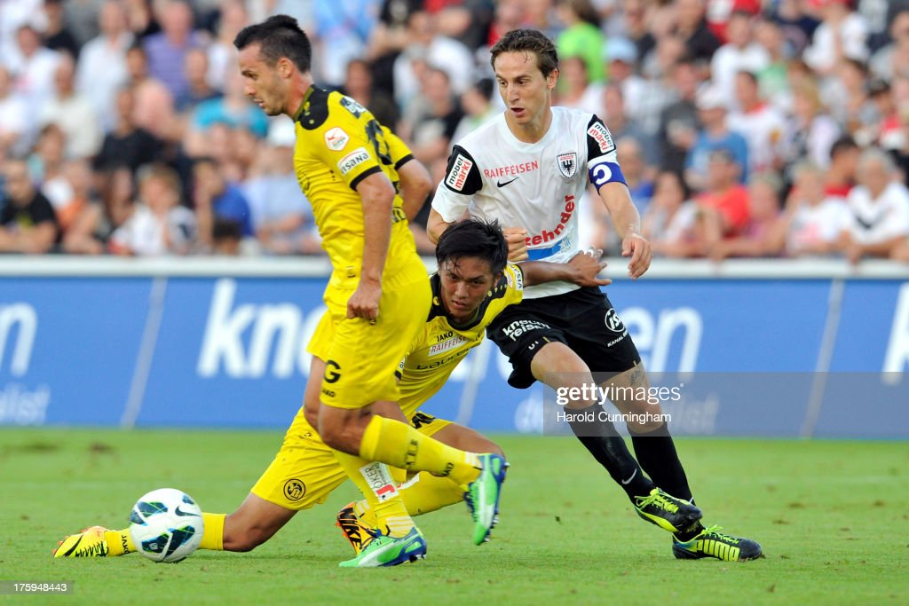Gonzalo Zarate (L) and Yuya Kubo (C) of BSC Young Boys in action against Sandro Burki (R) of FC Aarau during the Swiss Super League match between FC Aarau v BSC Young Boys at Brugglifeld on August 10, 2013 in Aarau, Switzerland.