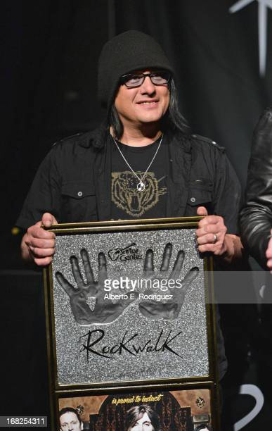 Goo Goo Dolls band member Robby Takac attends a ceremony inducting The Goo Goo Dolls into the Guitar Center RockWalk at Guitar Center on May 7 2013...