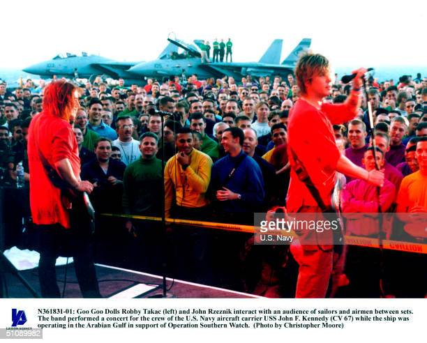 Goo Goo Dolls Robby Takac And John Rzeznik Interact With An Audience Of Sailors And Airmen Between Sets The Band Performed A Concert For The Crew Of...