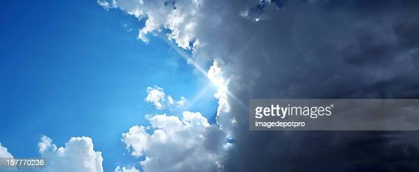 good and evil - cloudy sky stock pictures, royalty-free photos & images