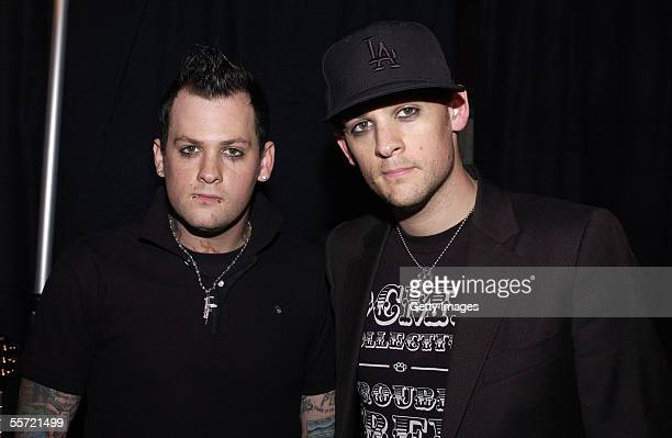 """Good Charlotte bandmates Benji and Joel Madden pose backstage at the """"ReAct Now: Music & Relief"""" benefit concert at Paramount Studios on September 9,..."""