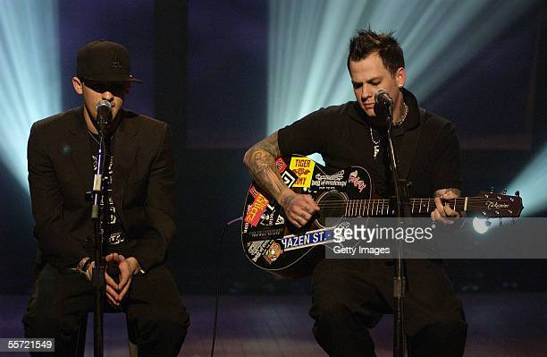 Good Charlotte bandmates Joel and Benji Madden perform at the 'ReAct Now Music Relief' benefit concert at Paramount Studios on September 9 2005 in...