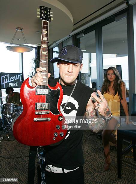 Good Charlotte's Benji Madden poses at the Gibson lounge in the Fantasy Suite gifting lounge during the 944 magazine anniversary party and unveiling...