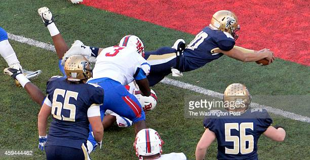 Good Counsels Andres Castillo dives in to score early in the third quarter against DeMatha in the Washington Catholic Athletic Conference football...