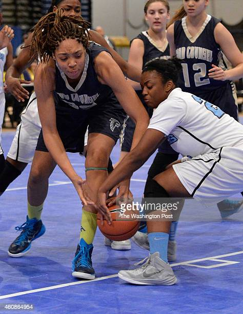 Good Counsel's Breonna Mayfield and Roosevelt's Alia Parker go for a loose ball in the Title IX Classic at the DC Armory on December 27, 2014 in...