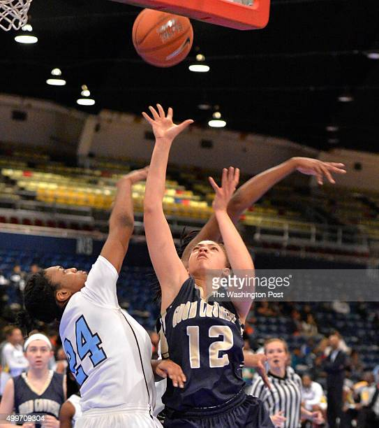 Good Counsel's Lindsey Pulliam put up a shot over Roosevelt's Alia Parker in the Title IX Classic at the DC Armory on December 27, 2014 in...