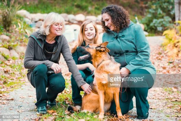 Good Dog Women having fun with cute german shepherd dog