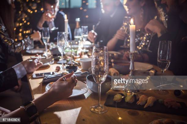 good food brought us together - christmas party stock photos and pictures