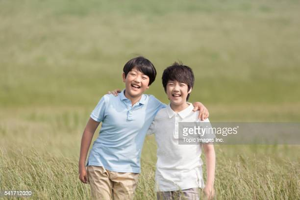 Good friends arms around each other smiling,Korean