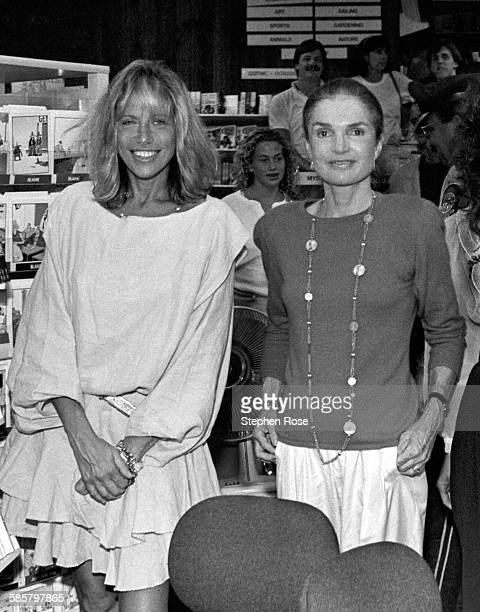 Good friends Carly Simon and Jackie Onassis pose for a picture at Bunch of Grapes Bookstore on Martha's Vineyard Massachusetts 9/2/89 Photo by...