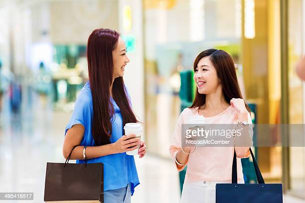 Good friends meeting at shopping mall