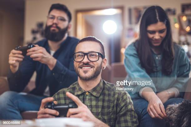 good friends playing games at home - gamer stock pictures, royalty-free photos & images