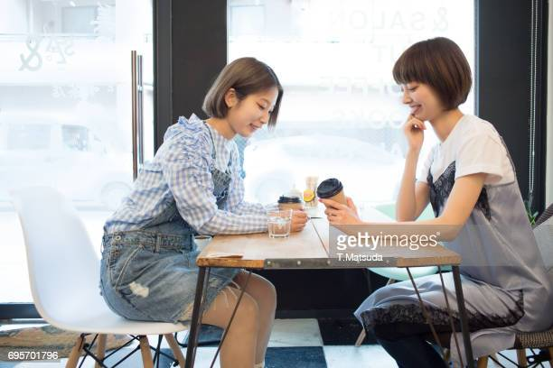 Good friends talk in cafe