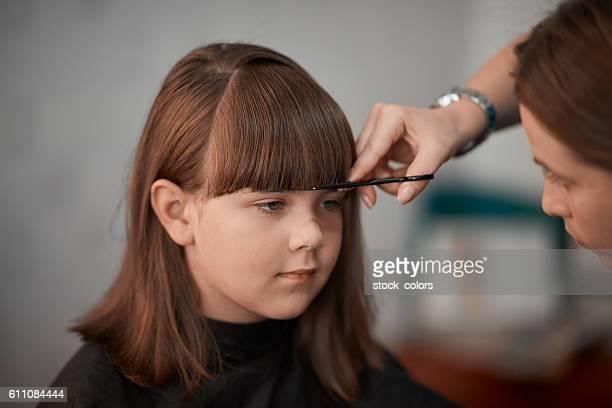 good little girl at hairdresser
