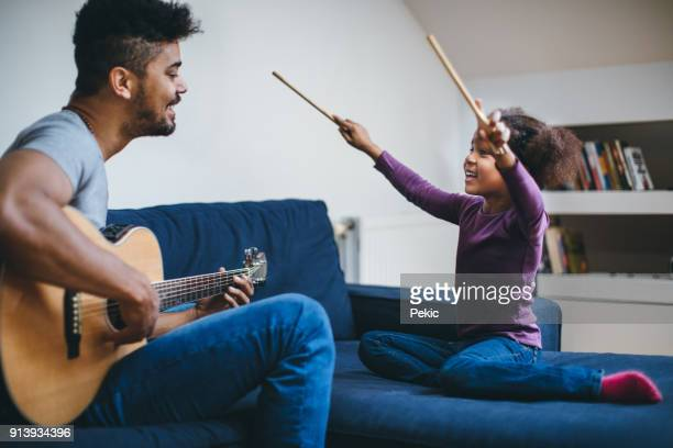 good looking caring father singing for his daughter - modern manhood stock pictures, royalty-free photos & images