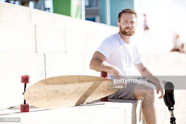Good looking casual amputee male posing at summer beach location