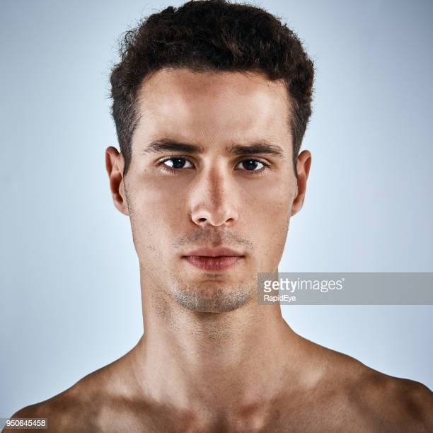 good looking, olive skinned, bare-chested young man looking serious - chest barechested bare chested imagens e fotografias de stock