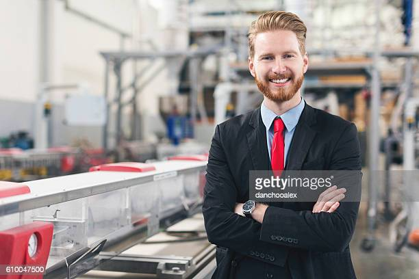 Good looking self-confident quality inspector at factory