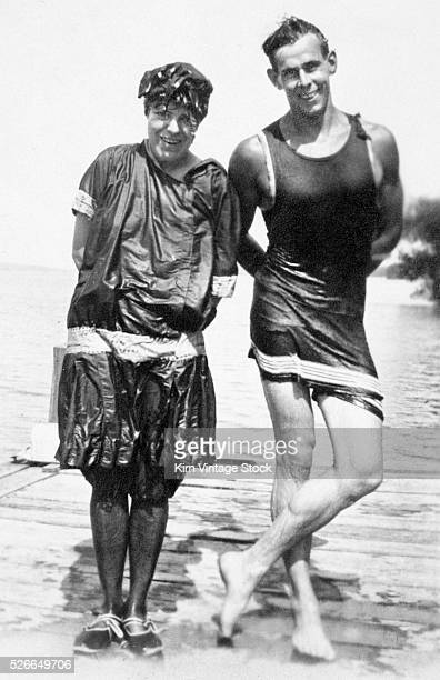 Good looking young couple stands for a portrait after emerging from the water after swimming