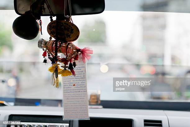 good luck charms in taxi, bangkok thailand - pendant stock pictures, royalty-free photos & images