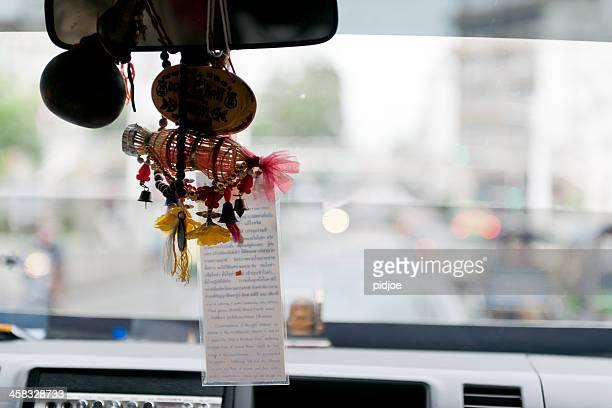 good luck charms in taxi, bangkok thailand - oorhanger stockfoto's en -beelden