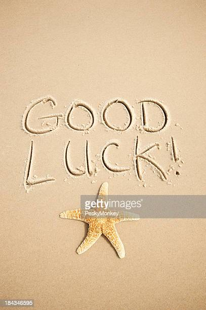 Good Luck Message Handwritten in Sand with Starfish