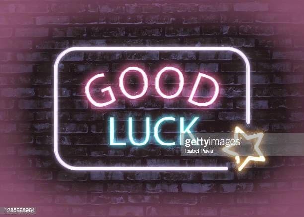 good luck sign in neon lights - luck stock pictures, royalty-free photos & images