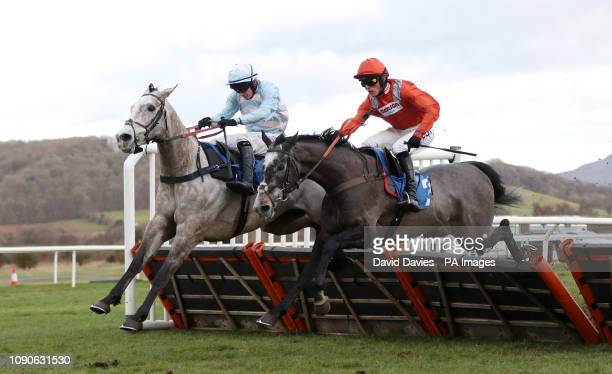 Good Man Jim ridden by Jonathan Burke jumps the last with Ashutor ridden by Harry Cobden in the Cafe V Maiden Hurdle at Ludlow Racecourse