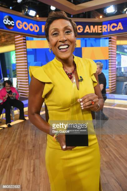 Good Morning America anchor Robin Roberts poses with the American Music Awards trophy during the 2017 American Music Awards nominations announcement...