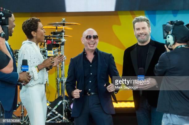 Good Morning America CoHost Robin Robins Rapper Pitbull and Actor John Travolta attend Pitbull's performance on ABC's 'Good Morning America' at...
