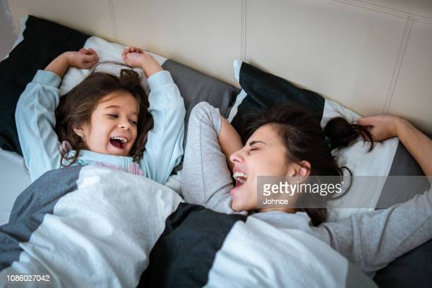 good morning - yawning mother child stock photos and pictures
