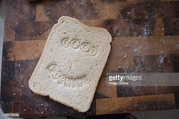 """Good morning"""""""" stamped into bread"""