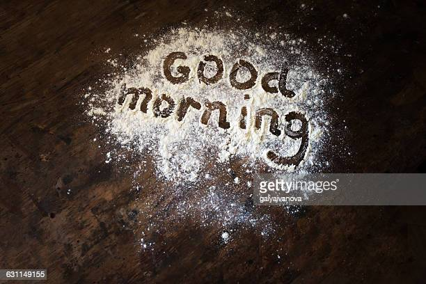 Good morning written in flour on kitchen table