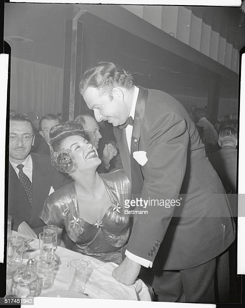 Good neighbors Xavier Cugat and Carmen Miranda are on smiling good terms too Carmen visited the Trocadero for Cugie's opening and Cugie came over to...