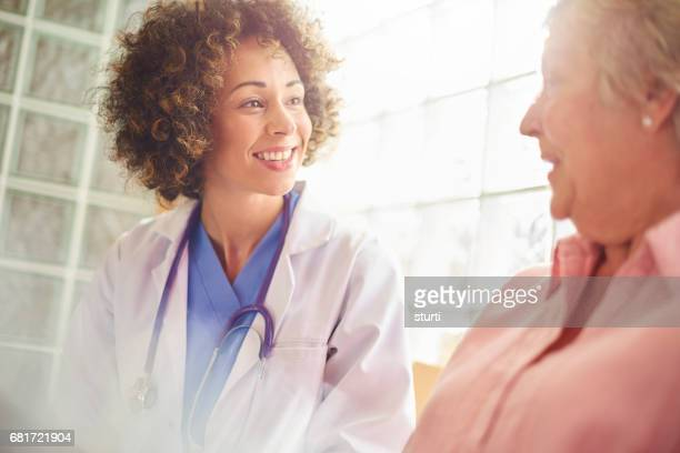 good news from the doctor - female doctor stock photos and pictures