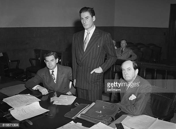 Good NewsOr Bad Los Angeles Calif Flanked by his attorneys Robert E Ford and Jerry Giesler actor Errol Flynn stands in Los Angeles courtroom as he...