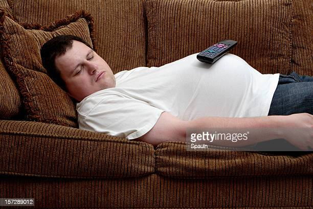 tv gut - unhealthy living stock pictures, royalty-free photos & images