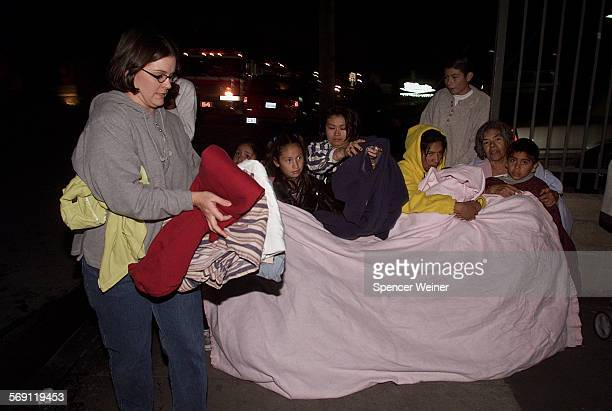 Good samaritian Alison Zegarski who lives across the street from apartments affected delivers blankets to her neighbors Several Hundred residents of...