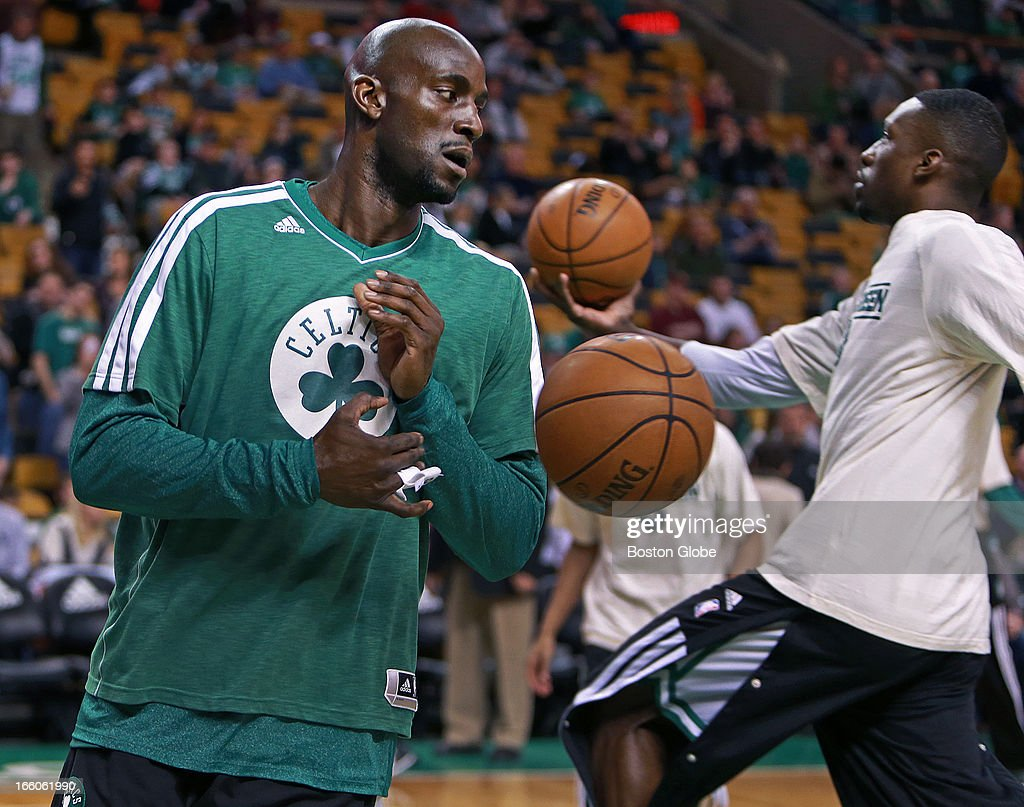 A good sign for the Celtics, as Kevin Garnett , left, is seen on the floor during pre-game warmups, teammate Jeff Green is at right. The Boston Celtics hosted the Washington Wizards in an NBA regular season game at TD Garden.