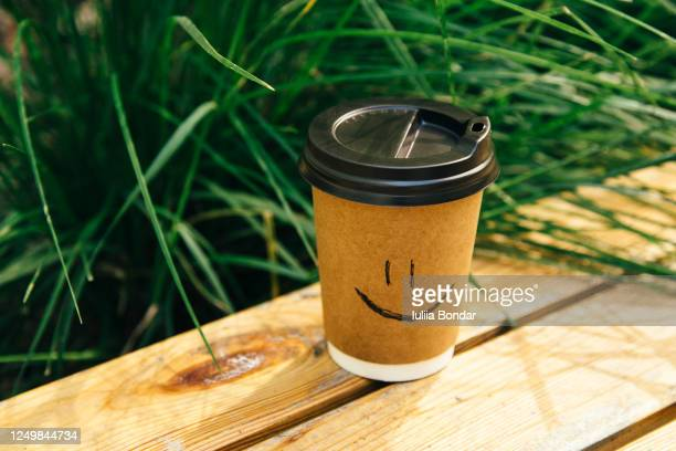 good start to the day - a cup of coffee in the fresh air - 袖 ストックフォトと画像